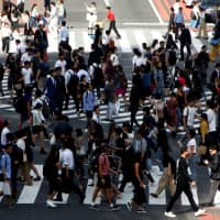 Japan's new statuses aim to allow people with knowledge and abilities Japan needs, in areas where local human resources are scarce, to work in the nation, where the population is aging and the workforce shrinking. | REUTERS