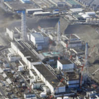 Four Japan firms used foreign trainees to clean up at Fukushima plant after nuclear meltdowns: final report
