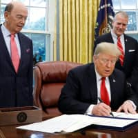 U.S. President Donald Trump signs the 'Save Our Seas Act of 2018' in the Oval Office at the White House in Washington on Thursday. | REUTERS