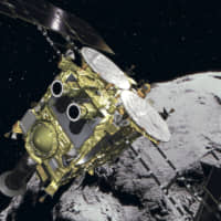This illustration provided by JAXA shows space probe Hayabusa2 approaching the Ryugu asteroid. JAXA said it has postponed the planned touchdown of Hayabusa2 to January from October. | JAXA VIA KYODO