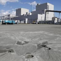 Evidence of soil liquefaction is seen on the grounds of the quake-hit Tomato-Atsuma thermal power plant in the town of Atsuma, Hokkaido, on Sept. 20. | KYODO