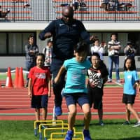 American track and field coach Darryl Woodson participates in an event held Sunday in Narita, Chiba Prefecture. The city will host the U.S. national field and track team for their pre-Olympic camp ahead of the 2020 Tokyo Olympics. | YOSHIAKI MIURA