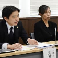 Yukie Omoto, mother of idol group member Honoka Omoto who committed suicide, attends a news conference in Matsuyama, Ehime Prefecture, Friday with her lawyer after suing her daughter's agency for damages. | KYODO