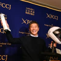 Zozo Inc. CEO Yusaku Maezawa, who is scheduled to travel to space in 2023, poses during a news conference in Tokyo on Tuesday. | YOSHIAKI MIURA