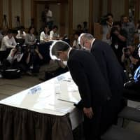 Officials from Tokyo Medical University bow at a news conference on Aug. 7 in Tokyo to apologize for the facility's manipulation of test scores to curb female enrollment. More medical schools are suspected to have disadvantaged female applicants, according to the education ministry. | KYODO