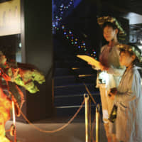Children take part in a night tour at the Okuizumo Tane Museum of Natural History in Okuizumo, Shimane Prefecture on Sept. 15. | KYODO