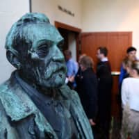 A statue of Swedish inventor and scholar Alfred Nobel is seen prior to a press conference at the Karolinska Institute in Stockholm, Sweden, on Monday. | AFP-JIJI
