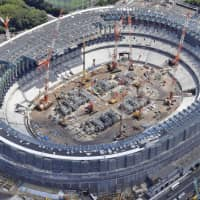 The new National Stadium in Tokyo's Shinjuku Ward, which is still under construction, is seen in this photo taken in July.   KYODO
