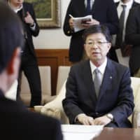 Tohoku Electric Power Co. President Hiroya Harada explains the decision to scrap the idled No. 1 unit at its Onagawa nuclear power plant during a meeting at the Miyagi Prefectural Government office on Thursday. | KYODO