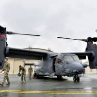 An MV-22 Osprey tilt-rotor aircraft is displayed for media at Yokota Air Base in western Tokyo last month ahead of its official deployment Monday. | KYODO