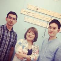 Honduran researcher Cristian Mejia (left), Nobuko Miyairi (center), who has worked in scholarly publishing for nearly two decades, and Yasutomo Takano, a researcher at the University of Tokyo, pose at their office in Tokyo's Shinbashi district. | COURTESY OF PAPER DIGEST