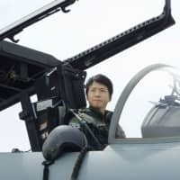 First Lt. Misa Matsushima of the Air Self-Defense Force, who is Japan's first-ever female fighter jet pilot, sits in a cockpit in August in Miyazaki Prefecture. | KYODO