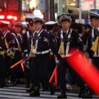 Police cordon off an area of Tokyo's Shibuya Ward after a fire broke out at a building near crowded celebrations to mark Halloween on Wednesday evening. | KYODO