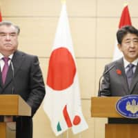 Prime Minister Shinzo Abe and Tajikistan's President Emomali Rahmon hold a joint news conference Friday following their talks at the Prime Minister's Office. | KYODO