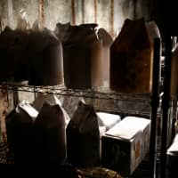 The unclaimed burial urns containing ashes of the dead are pictured at a facility that keeps the unclaimed urns in Yokosuka, Kanagawa Prefecture, last month. | REUTERS