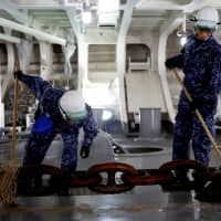 Japanese helicopter carrier wages daily war on dirt and grime
