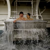 Sailors bathe in a sea water bath on the on the Maritime Self-Defense Force helicopter carrier Kaga.