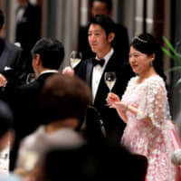 Imperial family members and Abe wish former princess and her commoner husband well at wedding banquet