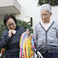 Sachiko Yasuda (left) and Hideaki Yasuda, parents of Jumpei Yasuda, speak to reporters Wednesday, following a report the previous day that he has been released. | KYODO