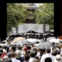 People visit Yasukuni Shrine in Tokyo on Aug. 15, the 73rd anniversary of Japan's surrender in World War II. The shrine honors the nation's war dead, as well as convicted war criminals. | KYODO