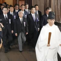 Lawmakers visit Yasukuni Shrine in Tokyo on Thursday during its annual autumn festival. | KYODO