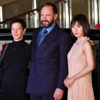 From left: Producer Gabrielle Tana and actors Ralph Fiennes and Mayu Matsuoka attend the opening of the 31st Tokyo International Film Festival on Thursday. | YOSHIAKI MIURA