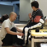 Do the elderly and disabled people in Japan want robots to look after them?