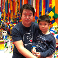 Junya Suzuki, a designer at The Lego Group, and his son at Legoland in Billund, Denmark.