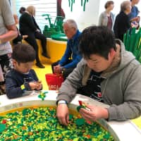 Junya Suzuki and his son enjoy a day at Legoland in Billund, Denmark.