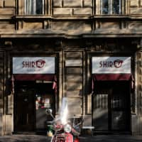 A growing empire: A red vespa in front of Shiro, the chef's new restaurant, located across the street from the original Poporoya. | LANCE HENDERSTEIN