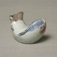 Water dropper in the shape of a carp, porcelain painted with blue and red underglaze (19th century) | THE JAPAN FOLK CRAFTS MUSEUM