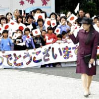Princess Ayako waves to residents in Sabae, Fukui Prefecture, on Oct. 5. | KYODO