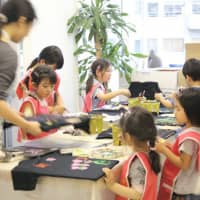 Little designers: Children learn to paint T-shirt designs for a Ray Art School kid's class. | RAY ART SCHOOL