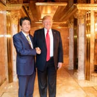 President Donald J. Trump and Prime Minister Shinzo Abe of Japan shake hands during their bilateral dinner meeting Sunday evening, Sept. 23, 2018, in the President's private residence at Trump Tower in New York City. ( | SHEALAH CRAIGHEAD