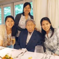 Princess Ayako (standing) with her older sisters Princess Tsuguko (left), Noriko Senge (right) and  their grandfather, the late Prince Mikasa, in Karuizawa, Nagano Prefecture, in August 2014. | KYODO