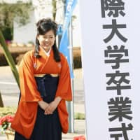 Princess Ayako at her graduation from Josai International University in Togane, Chiba Prefecture in March 2013. | KYODO