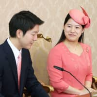 Princess Ayako and Kei Moriya at a press conference for their engagement in August. | KYODO