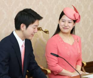 Princess Ayako and Kei Moriya at a press conference for their engagement in August.