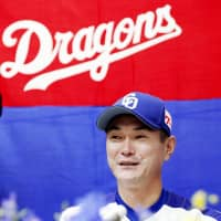Dragons reliever Hitoki Iwase speaks at a news conference on Tuesday at Nagoya Dome. | KYODO
