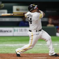 The Hawks' Alfredo Despaigne bashes a first-inning grand slam against the Fighters in Game 1 of the Pacific League Climax Series first stage at Yafuoku Dome on Saturday. Fukuoka SoftBank defeated Hokkaido Nippon Ham 8-3. | KYODO