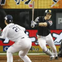 The Hawks' Seiji Uebayashi slaps a two-run triple in the fifth inning off the Lions' Ken Togame in Game 3 of the Pacific League Climax Series Final Stage at MetLife Dome on Friday night. Fukuoka SoftBank beat Seibu 15-4. | KYODO