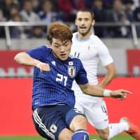 Ritsu Doan scores his first international goal on Tuesday at Saitama Stadium, giving Japan a 3-2 lead over Uruguay. | KYODO