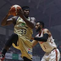 Ryukyu forward Ira Brown grabs a rebound in the first quarter of Friday night's game against Kawasaki in Okinawa City. The Golden Kings beat the Brave Thunders 68-60. | B. LEAGUE
