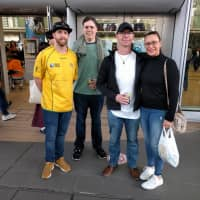 A group of Australian rugby fans including John Hart (far left) gather outside Shin-Yokohama Station before Saturday's Bledisloe Cup game. | ANDREW MCKIRDY