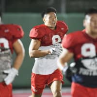 Defensive lineman Taisuke Miyagawa trains with his Nihon University Phoenix teammates for the first time since his controversial tackling incident in May.   KYODO