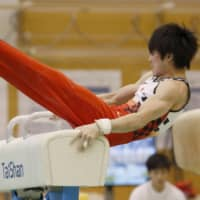 Kohei Uchimura is seen on the pommel horse during a recent workout at the National Training Center. | KYODO