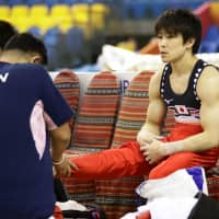 Kohei Uchimura injured his right ankle in September. | KYODO