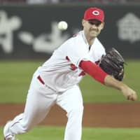 Carp pitcher Johnny Hellweg throws during Game 1 of the Japan Series at Mazda Stadium on Saturday.