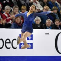 Mako Yamashita, a 15-year-old from Nagoya, captured the silver medal at Skate Canada on Saturday in her senior Grand Prix debut. | ERIC BOLTE / USA TODAY / VIA REUTERS