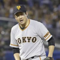 Giants pitcher Tomoyuki Sugano reacts after striking out Swallows slugger Wladimir Balentien on Sunday in Game 2 of the CL Climax Series' first stage at Jingu Stadium. | KYODO
